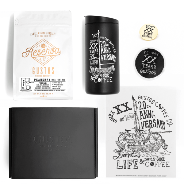 A specialty coffee gift set with a miir vacuum insulated tumbler, peaberry cafe, graphic art poster limited edition brass pin in a gift box from Puerto Rico